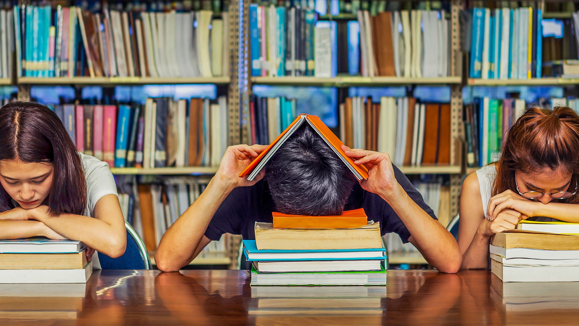 Students in library with study fatigue